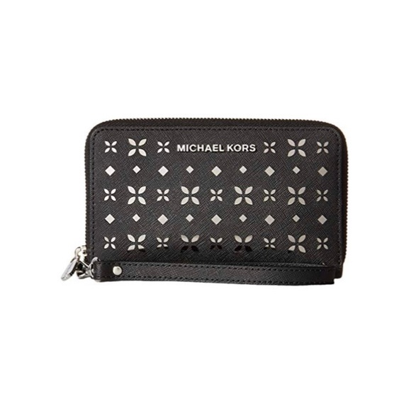 d6ae22933874 Jet Set Travel Flat Multifunction wallet. M 5be0a059194dad375b58f050